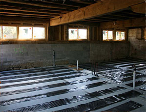 Electric floor heating system being installed.